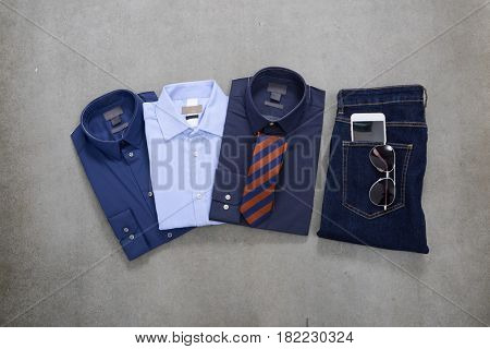 Men elegance shirt clothes, mobile phone on gray background