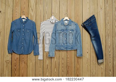 Set of Jeans shirt with two Blue jeans jacket, shirt - wooden background