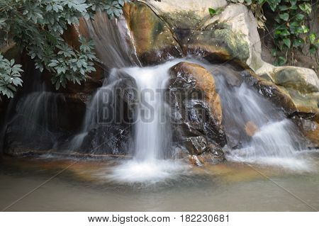 A small waterfall flowing over the rocks