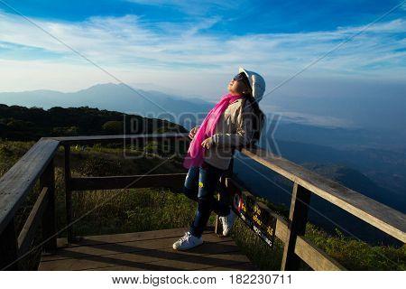 Girls look skyward at Kew Mae Pan viewpoint. poster