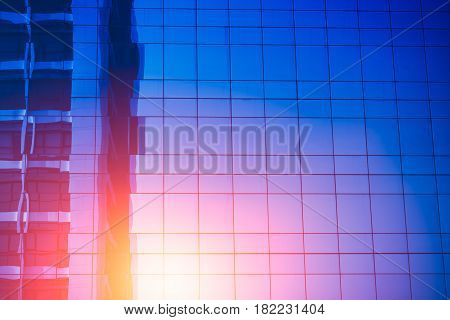 reflection of modern building. Glass of business tower blue color tone for background