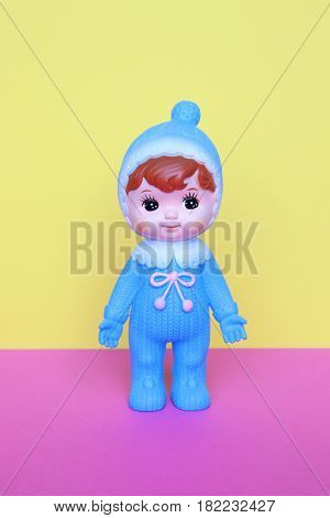 Cute vintage Japanese blue plastic doll on pastels color background.