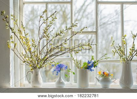 the bouquets of flowers on the windowsill