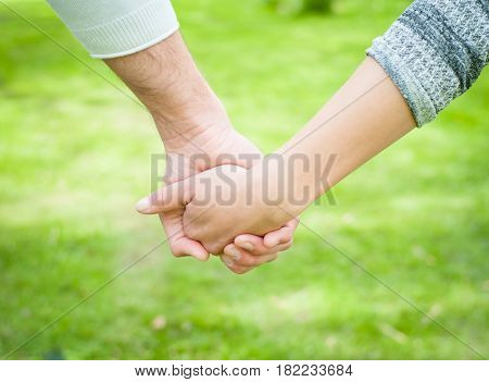 Couple holding hands outside