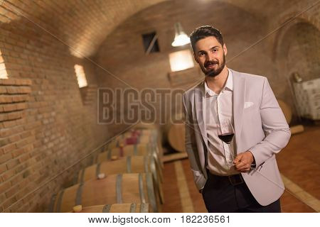 Oenologist tasting wines in wine grower cellar