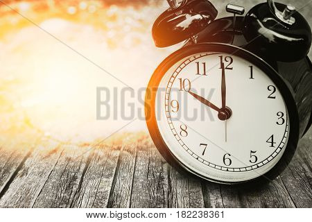 Old Memory Time Concept, Retro Clock Timed At 10 O'clock On Wood With Sun Light.
