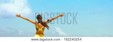 Fitness healthy lifestyle running woman banner panorama. Freedom happiness sporty girl with open arms in success on blue sky copy space.