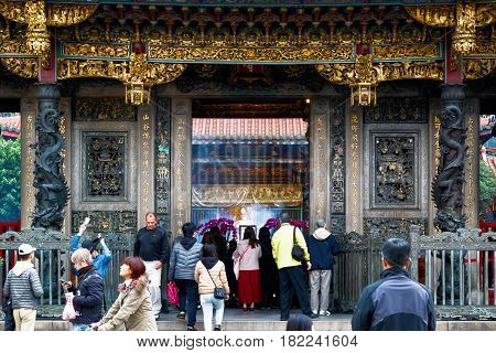 Taipei Taiwan - January 21 2017 - Lungshan Temple of Manka packed with worshippers and tourists