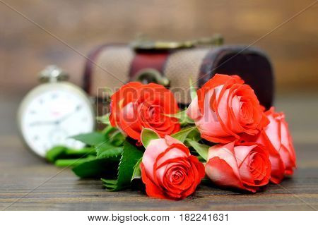 Happy Anniversary card with bouquet of red roses and pocket watch