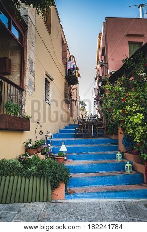 Rethymnon, Crete island, Greece. Cretan small street with stairs colored in blue.
