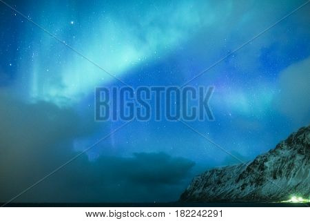 Amazing and Unique Nothern Lights Aurora Borealis Over Lofoten Islands in Norway Over the Polar Circle. Horizontal Shot