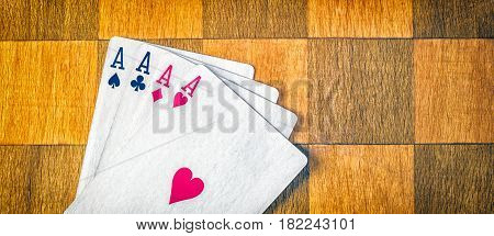 Four aces on the chessboard is a very strong combination of playing cards in poker practically winning in your pocket