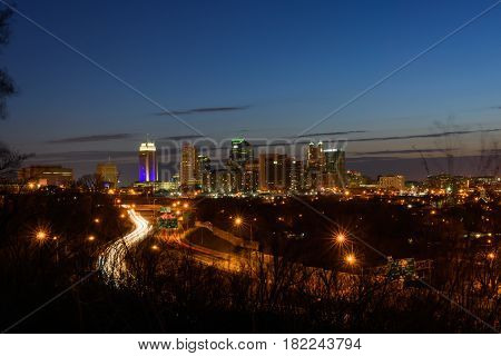 KC Cityscape at night fall showing the busy highway