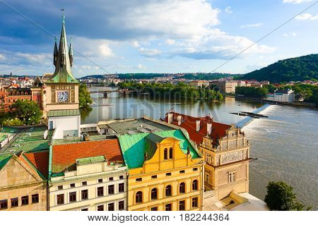 Aerial view over the old town of Prague and Vltava river in late afternoon summer