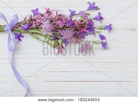 the bluebell flowers om white wooden background