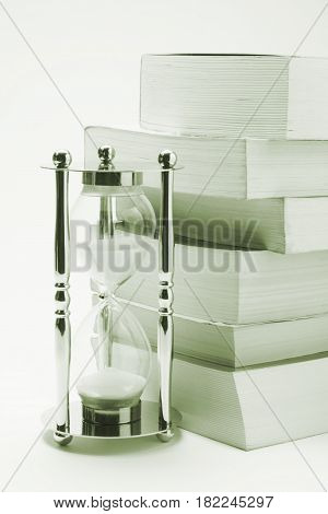 Hourglass and Books in Light Grey Tone