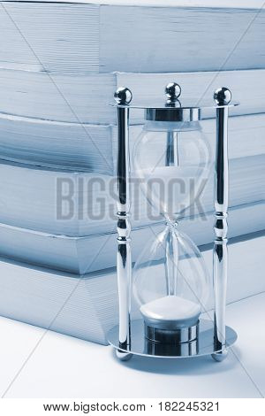 Hourglass and Books in Light Blue Tone