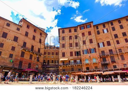 Siena Italy-July 4 2016: Cafe and restaurants with lot of tourists at Piazza del Campo; one of Europe's greatest medieval squares.