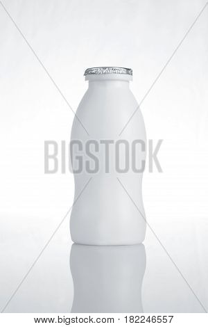 White Milk Bottle on White Background with Reflection