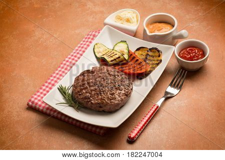 hamburger with grilled pepper end zucchinis