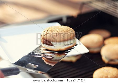 Cheeseburgers on the grill