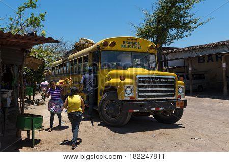 Granada Nicaragua - April 4 2014: People entering an old public bus in Granada Nicaragua
