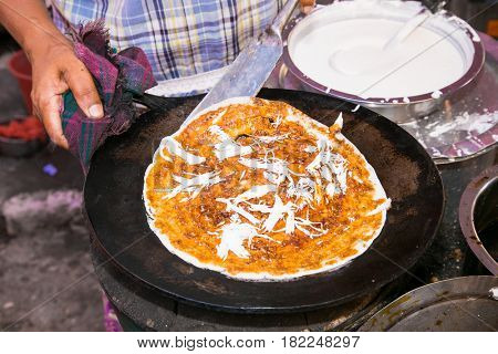 Fried pizza with oil in the street in Yangon, Myanmar. (Burma)