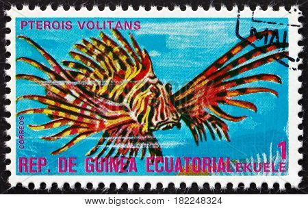 EQUATORIAL GUINEA - CIRCA 1975: a stamp printed in Equatorial Guinea shows Red Lionfish Pterois Volitans Tropical Fish circa 1975