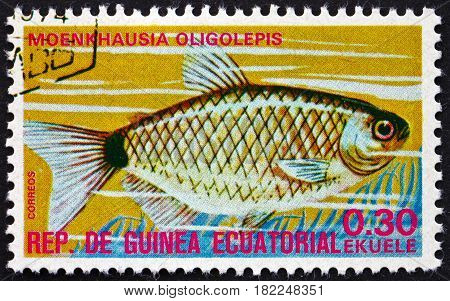 EQUATORIAL GUINEA - CIRCA 1975: a stamp printed in Equatorial Guinea shows Glass Tetra Moenkhausia Oligolepis Tropical Fish circa 1975