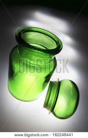 Empty Green Glass Jar with Light Streaks