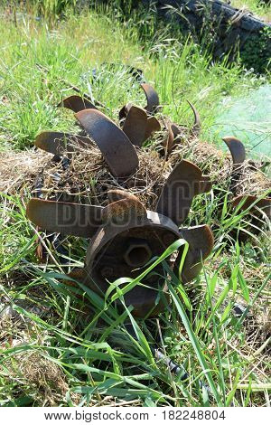 Cutters Of An Old Rotary Tiller Full Of Weeds
