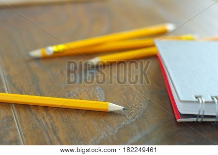Drawing pencil with notebook on desk table working place. Idea memories reminder concept. Personal notepaper kit.