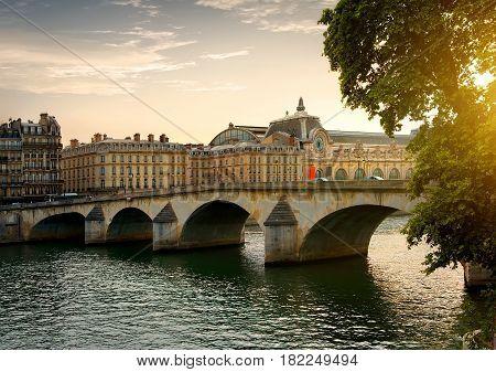 Bridge Orsay in Paris at sunny evening, France