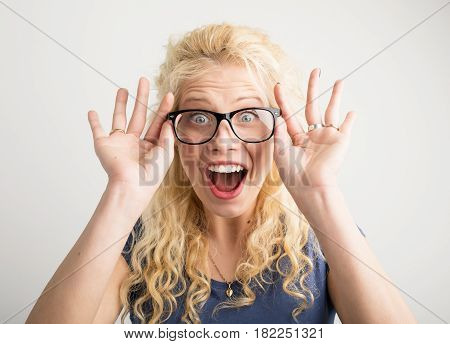 Happy woman with new optical glasses showing her excitement