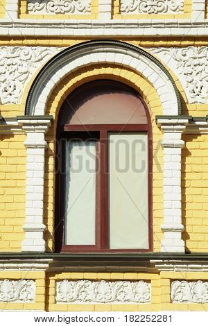 Arched window with decorated brick wall background