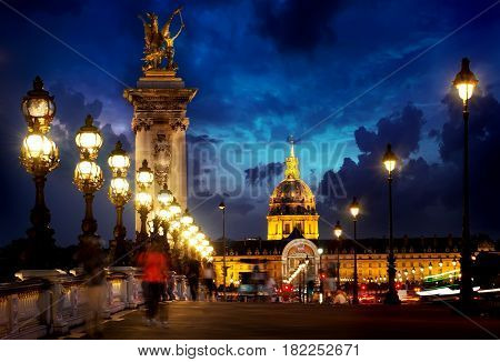 Pont Alexandre III and Les Invalides in Paris in the evening, France