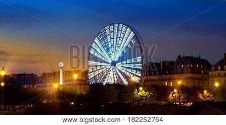 Luminous Ferris Wheel in the evening Paris, France