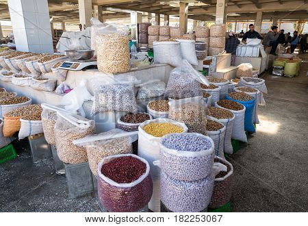 SAMARKAND UZBEKISTAN - OCTOBER 15 2016: Selling different types of nuts in Siab market