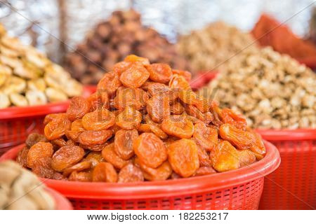 Dried apricots. Sale of dried fruits in the market