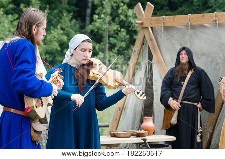 RITTER WEG MOROZOVO APRIL 2017: Medieval musicians outdoor play music instruments medieval festival