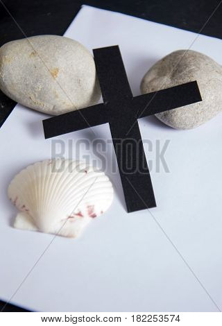 funeral card - a black ribbon and stones