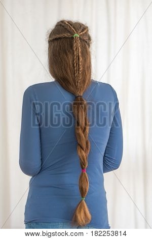 Single plait renaissance hairstyle for long hair. Traditional plait style modelled by girl with very long golden hair