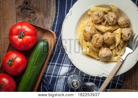 Pork meatballs with dill sauce and pasta. Selective focus.