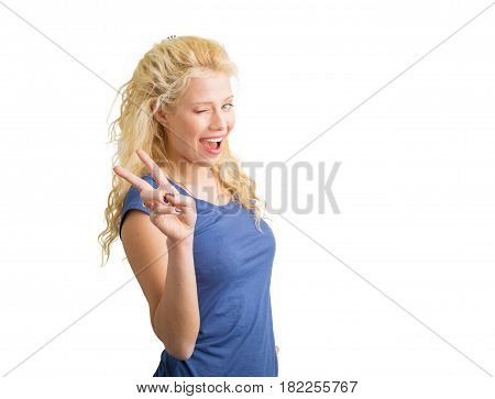 Girl winking and showing piece sign with hand