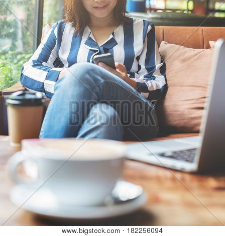 Relaxed Asian Woman using cell phone. Happiness eyeglasses girl smiling.