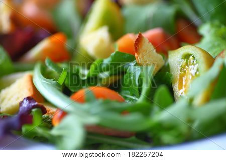 Salad of various lettuces and baby heirloom tomatoes with croutons