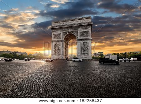 Triumphal Arch and clouds at sunrise in Paris, France