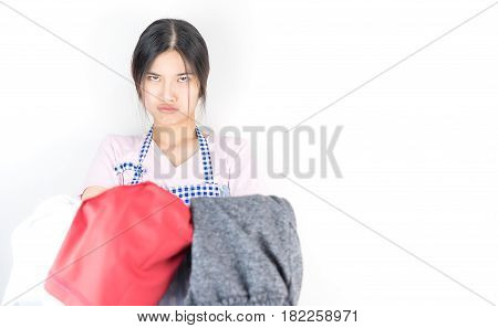 Housewife is tried and angry with a lot of clothes for laudry