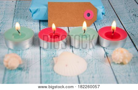 paper tag with tea lights and shells