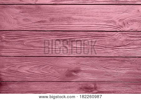 Pink painted wood board texture and background. Pink natural wooden background. Wood planks pattern. Wooden surface. Horizontal timber texture. Pink wood barn.
